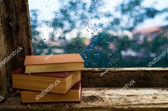 stock-photo-books-on-the-windowsill-of-an-old-wooden-window-479498809.jpg