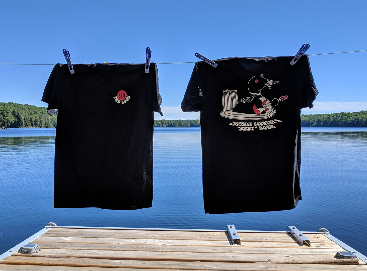 Back and front of Loon tshirt on a dock