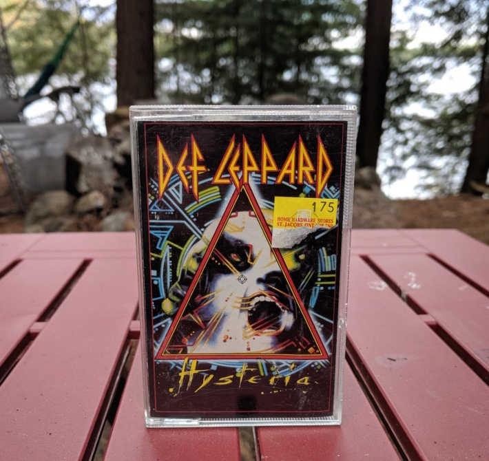Def Leppard's Hysteria cassette in the forest