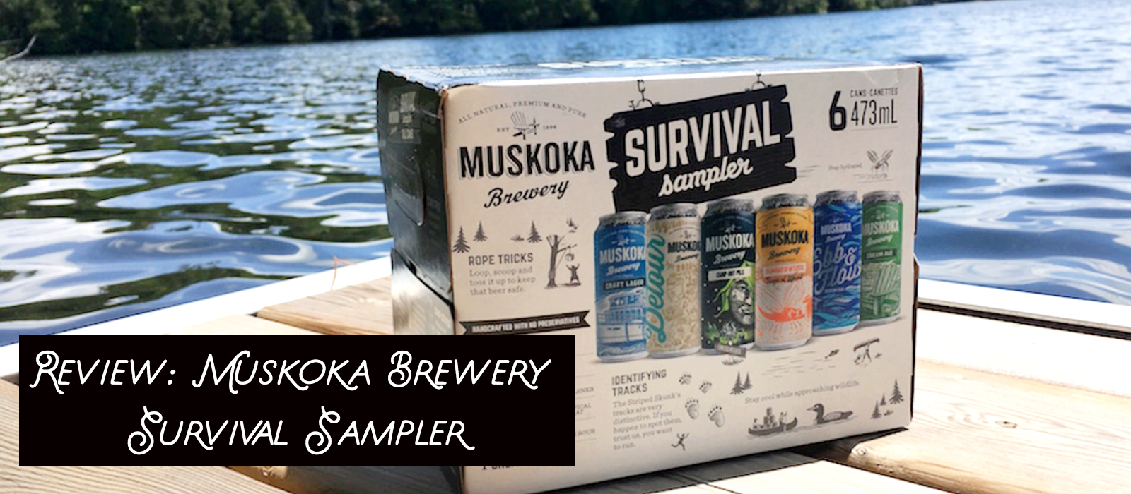 Muskoka Brewery Survival Sampler box with beers pictured on it, sitting on a dock near the lakeside