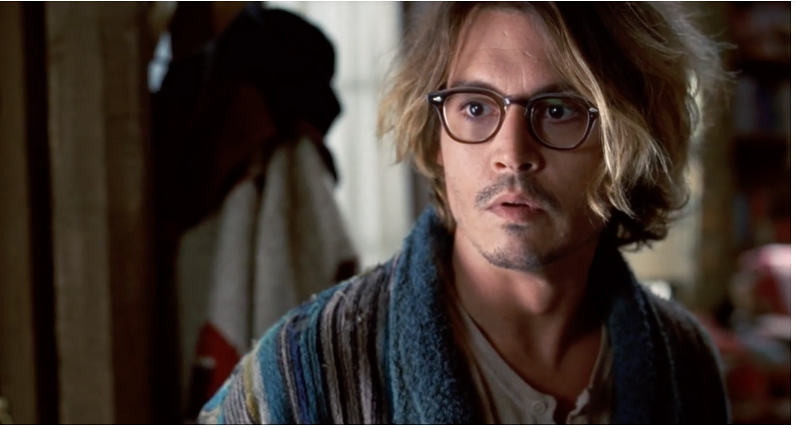Johnny Depp looking unsettled in house coat