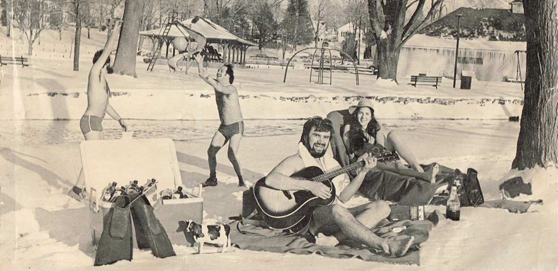 Friends gathered in a park during the winter, doing summer things. Playing ball in swimsuits, having a picnic, playing guitar