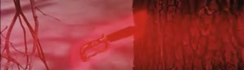 Glowing red knife sticking in tree