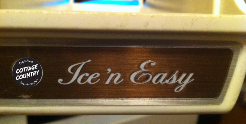 An old refrigerator ice tray that says: Ice 'n Easy in cursive font