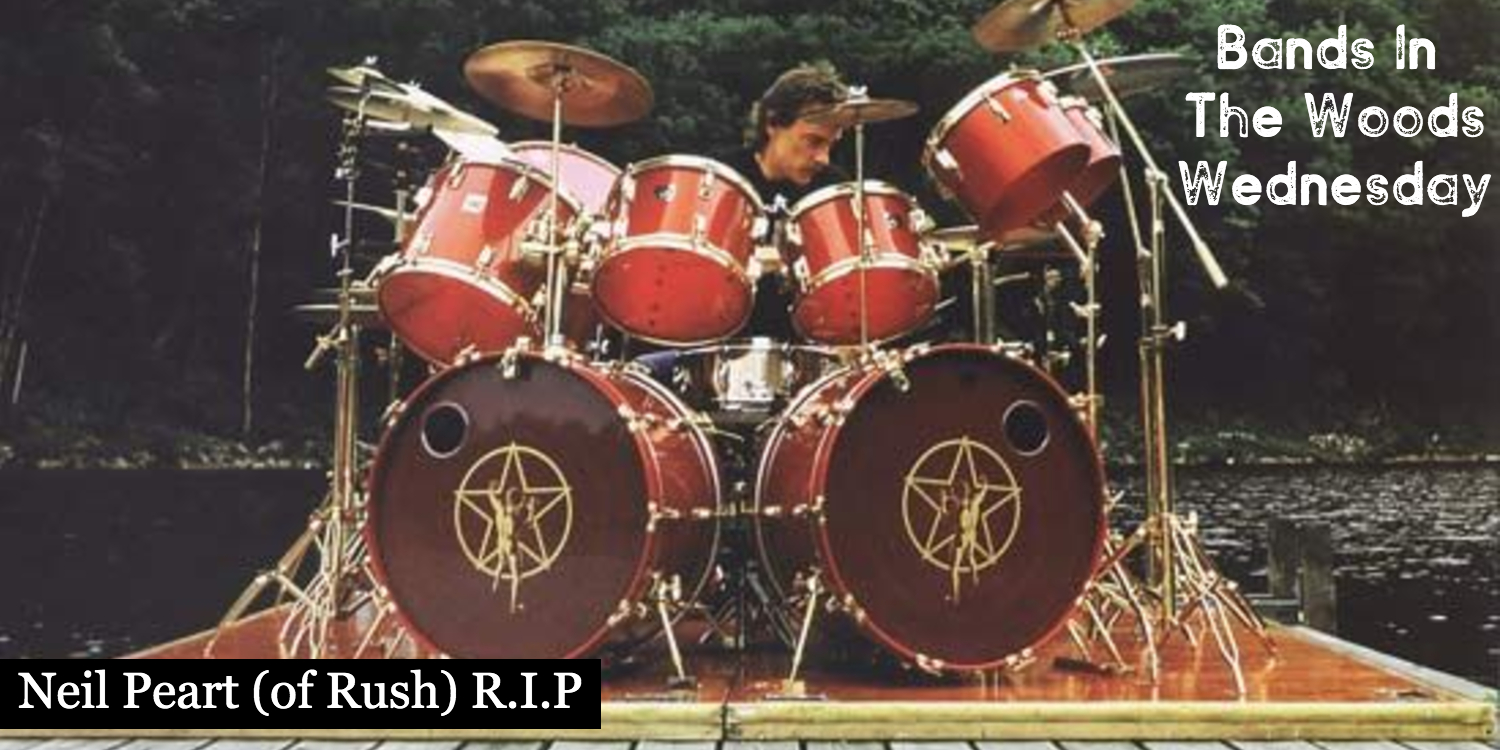 Neil Peart of Rush Playing Drums On A Dock In The Forest