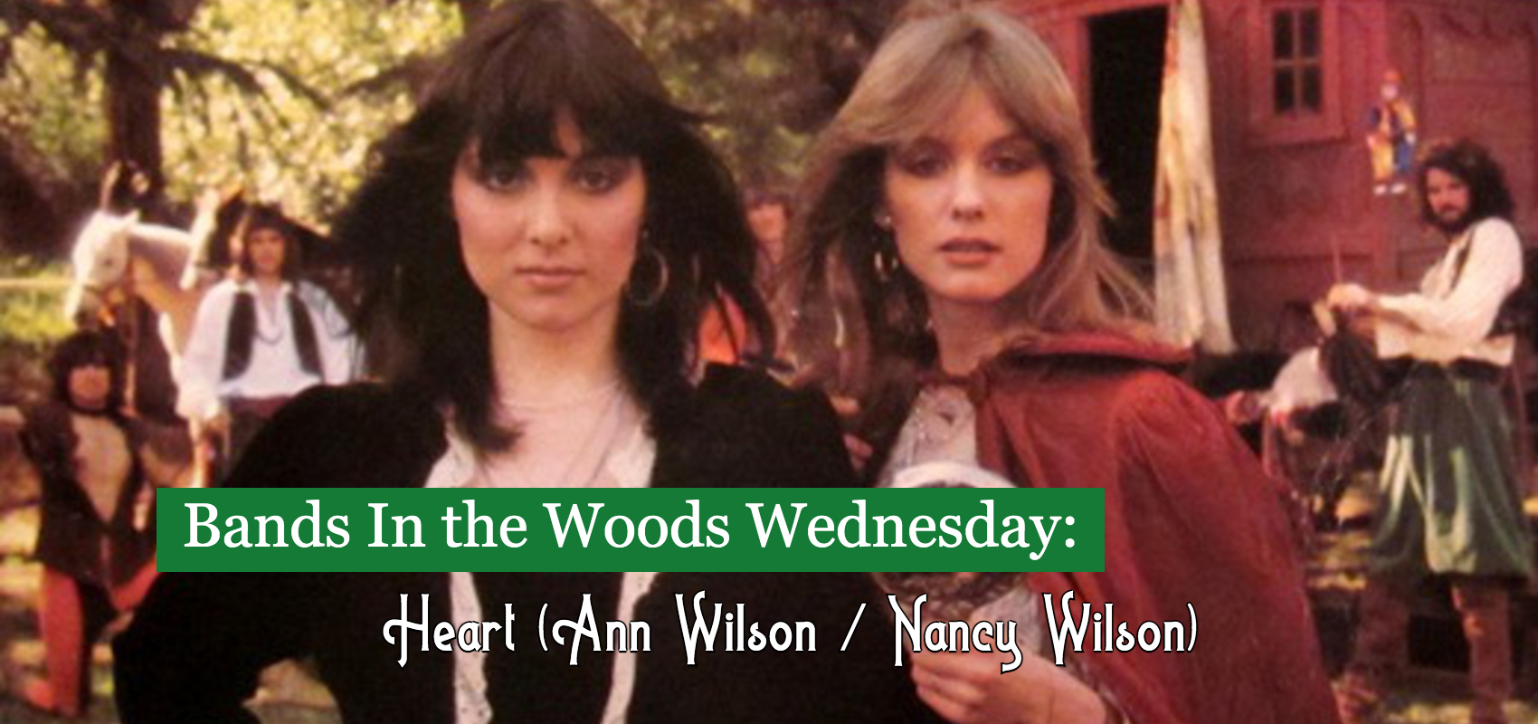 Ann Wilson and Nancy Wilson of Heart stand outdoors in front of a Gypsy caravan