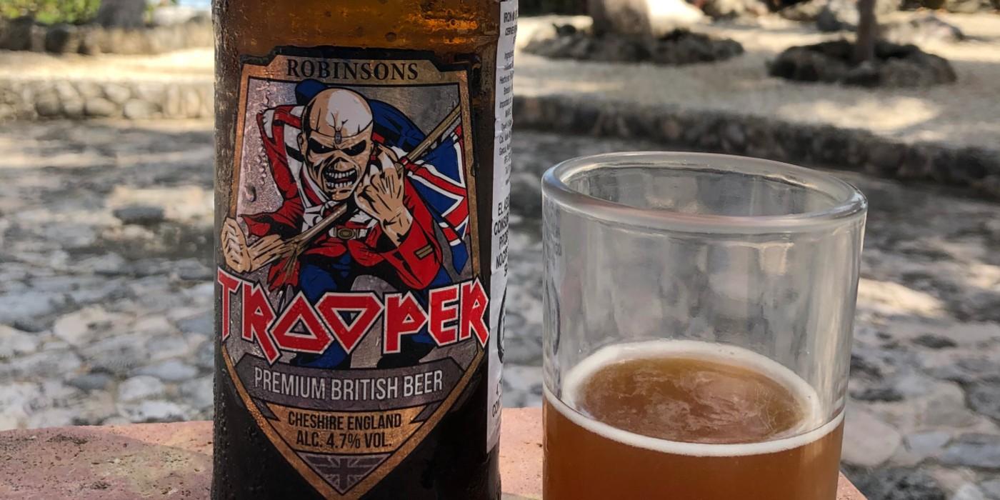 Iron Maiden Trooper Beer beside a glass of beer