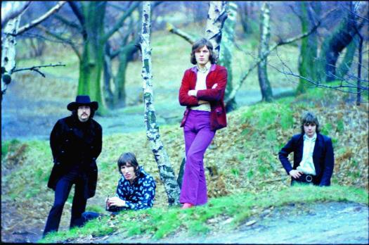 Pink Floyd with David Gilmour standing in a wooded area from the 1960's