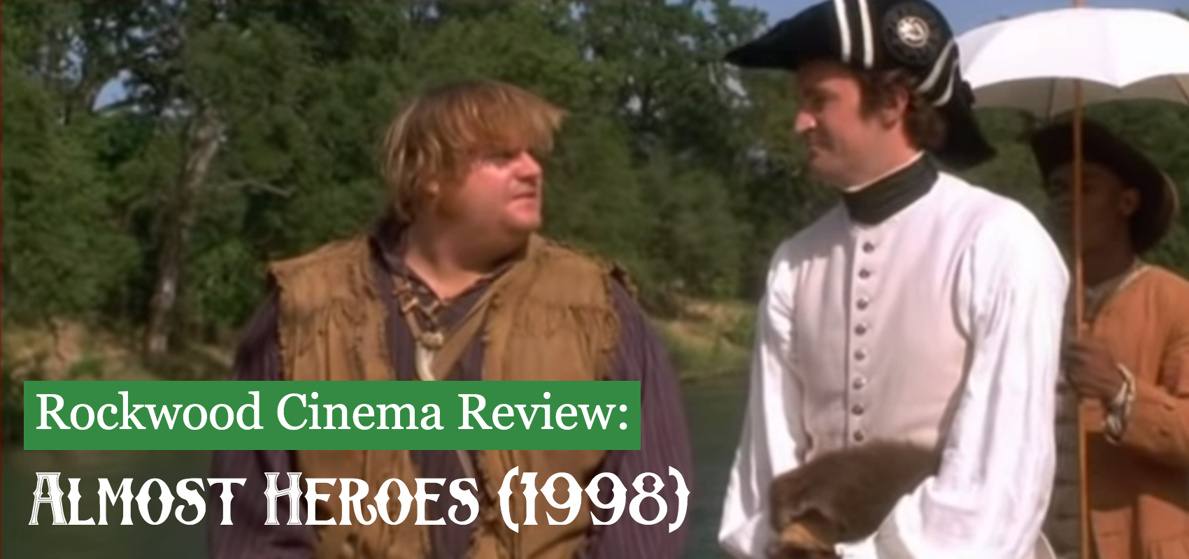 A dishevelled Chris Farley looks at Matthew Perry wearing a colonial hat and white puffy armed shirt in the woods.