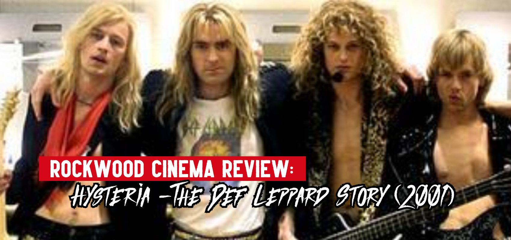 Actors playing the band Def Leppard pose for a backstage photo from the movie.