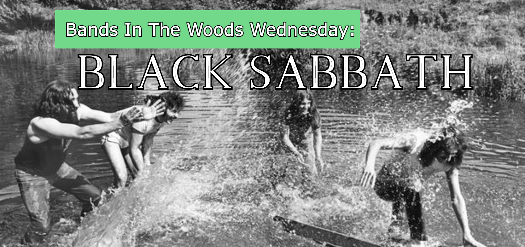 The members of Black Sabbath play in a shallow pond, splashing each other