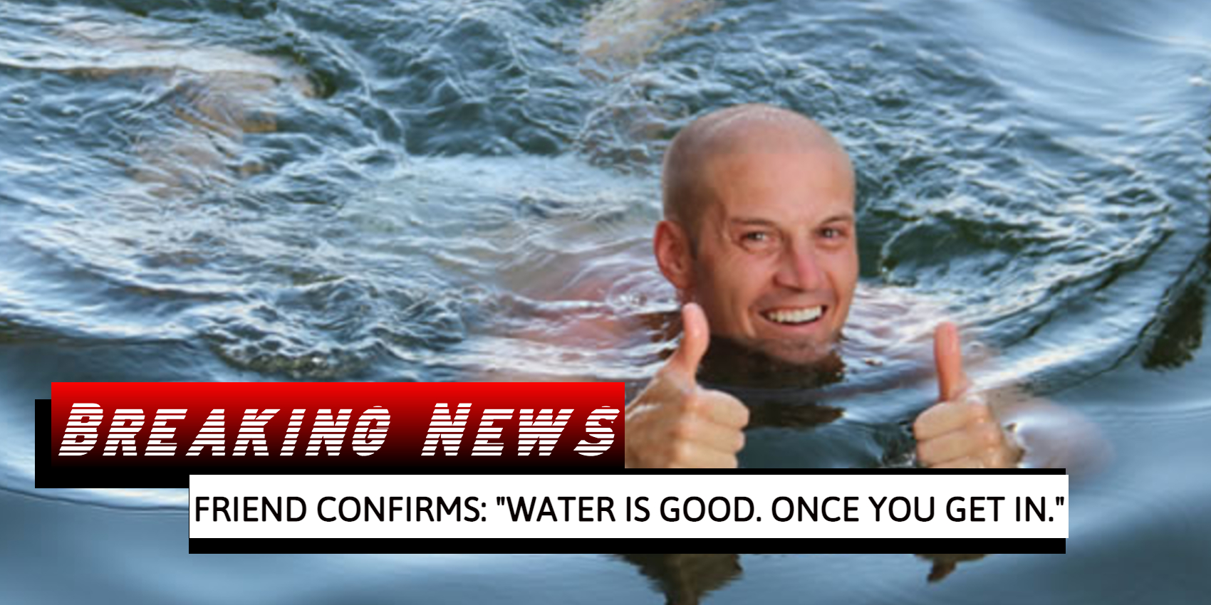 Man swims with thumbs up
